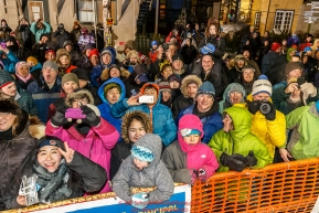 A crowd is on hand to watch Dallas Seavey win the 44th running of the Iditarod Sled Dog Race in Nome on Tuesday March 15th during the 2016 Iditarod in record time of 8 Days 11 hours 20 minutes 16 seconds     Photo by Jeff Schultz (C) 2016  ALL RIGHTS RESERVED
