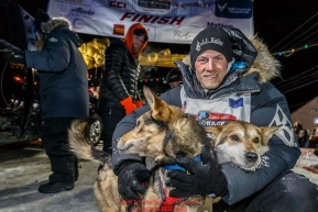 Dallas Seavey poses with his lead dogs shortly after winning the 44th running of the Iditarod Sled Dog Race in Nome on Tuesday March 15th during the 2016 Iditarod in record time of 8 Days 11 hours 20 minutes 16 seconds    Photo by Jeff Schultz (C) 2016  ALL RIGHTS RESERVED