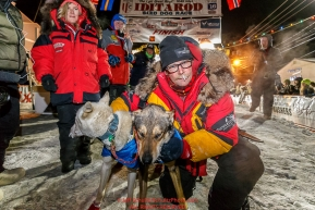 Mitch Seavey poses with his lead dogs after arriving in second place at the finish line in Nome on Tuesday March 15th during the 2016 Iditarod.  Alaska    Photo by Jeff Schultz (C) 2016  ALL RIGHTS RESERVED
