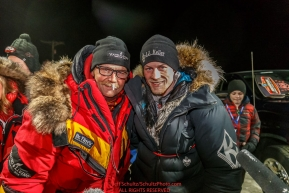 First place finisher Dallas Seavey (R) poses with his dad, Mitch Seavey, who finished in second place at the finish line in Nome on Tuesday March 15th during the 2016 Iditarod.  Alaska    Photo by Jeff Schultz (C) 2016  ALL RIGHTS RESERVED