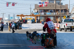 Ryan Redington runs down Front Street toward the finish line in Nome during the 2017 Iditarod on Wednesday March 15, 2017.Photo by Jeff Schultz/SchultzPhoto.com  (C) 2017  ALL RIGHTS RESERVED