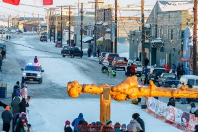 Sebastien Vergnaud runs down Front street and into the finish chute in Nome during the 2017 Iditarod on Wednesday March 15, 2017.Photo by Jeff Schultz/SchultzPhoto.com  (C) 2017  ALL RIGHTS RESERVED