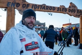 Sebastien Vergnaud at the finish line in Nome during the 2017 Iditarod on Wednesday March 15, 2017.Photo by Jeff Schultz/SchultzPhoto.com  (C) 2017  ALL RIGHTS RESERVED