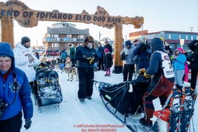 Richie Diehl runs across the finish line in Nome just after Sebastien Vergnaud finished during the 2017 Iditarod on Wednesday March 15, 2017.Photo by Jeff Schultz/SchultzPhoto.com  (C) 2017  ALL RIGHTS RESERVED