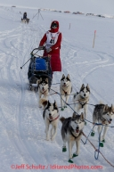 Lisbet Norris followed closely by Marcelle Fressineau on the trail a few miles from the Nome finish line on her way to Nome on Saturday March 15 during the 2014 Iditarod Sled Dog Race.PHOTO (c) BY JEFF SCHULTZ/IditarodPhotos.com -- REPRODUCTION PROHIBITED WITHOUT PERMISSION