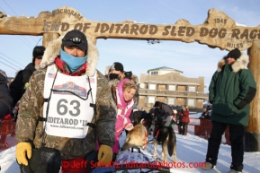 Russian musher Mikhail Telpin at the finish line on Front Street in Nome. Iditarod Sled Dog Race 2013Photo by Jeff Schultz copyright 2013 DO NOT REPRODUCE WITHOUT PERMISSION