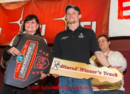 Dallas Seavey gets his key for his new Dodge RAM truck from Anchorage Chrysler Dodge at the musher 's finishers banquet in Nome on Sunday March 16 after the 2014 Iditarod Sled Dog Race.PHOTO (c) BY JEFF SCHULTZ/IditarodPhotos.com -- REPRODUCTION PROHIBITED WITHOUT PERMISSION