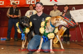 Dallas Seavey and his lead dogs Beatle and Reef pose for photos at the musher 's finishers banquet in Nome on Sunday March 16 after the 2014 Iditarod Sled Dog Race.PHOTO (c) BY JEFF SCHULTZ/IditarodPhotos.com -- REPRODUCTION PROHIBITED WITHOUT PERMISSION