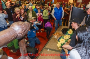 A crowd of race fans take photos of Dallas Seavey and his lead dogs Beatle and Reef as they pose at the musher 's finishers banquet in Nome on Sunday March 16 after the 2014 Iditarod Sled Dog Race.PHOTO (c) BY JEFF SCHULTZ/IditarodPhotos.com -- REPRODUCTION PROHIBITED WITHOUT PERMISSION