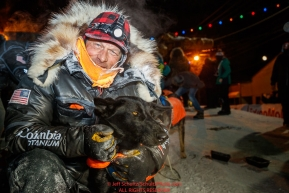Martin Buser poses with his lead dog at the finish line in Nome during the 2017 Iditarod on Thursday March 16, 2017.Photo by Jeff Schultz/SchultzPhoto.com  (C) 2017  ALL RIGHTS RESERVED