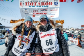Kristy and Anna Berington pose at the finish line in Nome shorlty after finishing during the 2017 Iditarod on Thursday March 16, 2017.Photo by Jeff Schultz/SchultzPhoto.com  (C) 2017  ALL RIGHTS RESERVED