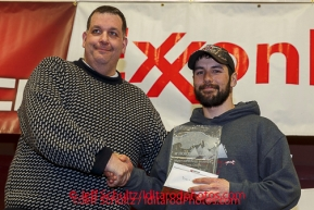 Kenny Gill presents the Horizon Lines Most Improved Musher Award to Richie Diehl at the musher 's finishers banquet in Nome on Sunday March 16 after the 2014 Iditarod Sled Dog Race.PHOTO (c) BY JEFF SCHULTZ/IditarodPhotos.com -- REPRODUCTION PROHIBITED WITHOUT PERMISSION