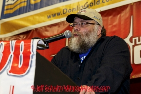 Race Marshal Mark Nordman announces the checkpoint of Galena as the Golden Clipboard award winner for the best checkpoint at the musher 's finishers banquet in Nome on Sunday March 16 after the 2014 Iditarod Sled Dog Race.PHOTO (c) BY JEFF SCHULTZ/IditarodPhotos.com -- REPRODUCTION PROHIBITED WITHOUT PERMISSION