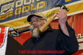 Race Marshal Mark Nordman announces a Golden Hammer award to volunteer Jim Paulus for all his help on the race at the musher 's finishers banquet in Nome on Sunday March 16 after the 2014 Iditarod Sled Dog Race.PHOTO (c) BY JEFF SCHULTZ/IditarodPhotos.com -- REPRODUCTION PROHIBITED WITHOUT PERMISSION