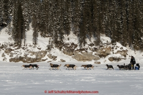 Dallas Seavey runs down the Fish River shorlty after leaving the White Mountain checkpoint on Tuesday March 16, 2015 during Iditarod 2015.  (C) Jeff Schultz/SchultzPhoto.com - ALL RIGHTS RESERVED DUPLICATION  PROHIBITED  WITHOUT  PERMISSION