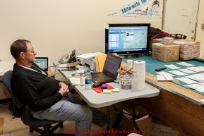 Volunteer Rob Johnson working in the early morning at the Unalakleet checkpoint on Tuesday March 16, 2015 during Iditarod 2015.  (C) Jeff Schultz/SchultzPhoto.com - ALL RIGHTS RESERVED DUPLICATION  PROHIBITED  WITHOUT  PERMISSION