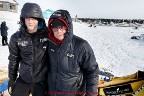 Father and son Mitch and Dallas Seavey pose for a photo in the afternoon at the White Mountain checkpoint on Tuesday March 16, 2015 during Iditarod 2015.  (C) Jeff Schultz/SchultzPhoto.com - ALL RIGHTS RESERVED DUPLICATION  PROHIBITED  WITHOUT  PERMISSION