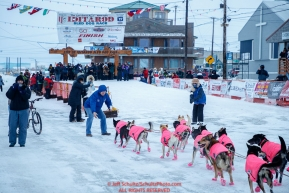 Volunteer security guards help steer DeeDee Jonrowe team off of Front Street and into the finish chute in Nome during the 2017 Iditarod on Friday March 17, 2017.Photo by Jeff Schultz/SchultzPhoto.com  (C) 2017  ALL RIGHTS RESERVED