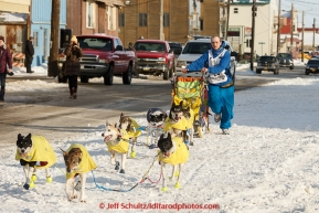 Wade Marrs runs down Front Street on the way to the Nome finish line on Wednesday March 18, 2015 during Iditarod 2015.  (C) Jeff Schultz/SchultzPhoto.com - ALL RIGHTS RESERVED DUPLICATION  PROHIBITED  WITHOUT  PERMISSION