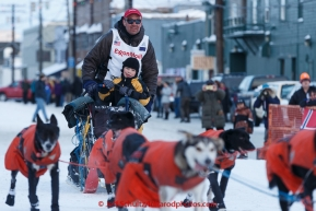 Ken Anderson enters the Nome finish chute with his 6-year old son Leif riding the last way on Wednesday March 18, 2015 during Iditarod 2015.  (C) Jeff Schultz/SchultzPhoto.com - ALL RIGHTS RESERVED DUPLICATION  PROHIBITED  WITHOUT  PERMISSION