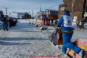 Wade Marrs runs into the finish chute on the way to the Nome burl arch finish line on Wednesday March 18, 2015 during Iditarod 2015.   (C) Jeff Schultz/SchultzPhoto.com - ALL RIGHTS RESERVED DUPLICATION  PROHIBITED  WITHOUT  PERMISSION