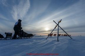 Ken Anderson runs past a tripod trail marker on the trail several miles from the Nome finish line near sunset on Wednesday March 18, 2015 during Iditarod 2015.  (C) Jeff Schultz/SchultzPhoto.com - ALL RIGHTS RESERVED DUPLICATION  PROHIBITED  WITHOUT  PERMISSION