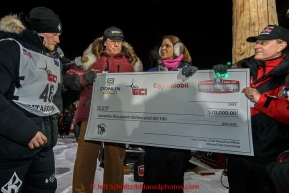 Dallas Seavey recieves his $70,000 first-place check after winning his 3rd Iditarod in 8 days 18 hours 13 minutes 6 seconds on Wednesday March 18, 2015 during Iditarod 2015.  (C) Jeff Schultz/SchultzPhoto.com - ALL RIGHTS RESERVED DUPLICATION  PROHIBITED  WITHOUT  PERMISSION