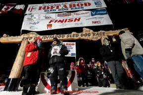 Dallas Seavey talks with Leo Rassumuson after winning his 3rd Iditarod in 8 days 18 hours 13 minutes 6 seconds with lead dogs Reef and Hero on Wednesday March 18, 2015 during Iditarod 2015.  (C) Jeff Schultz/SchultzPhoto.com - ALL RIGHTS RESERVED DUPLICATION  PROHIBITED  WITHOUT  PERMISSION