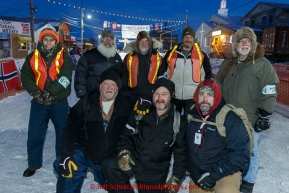 Volunteer Security guards pose for a photo at the Nome finish line on Wednesday March 18, 2015 during Iditarod 2015.  (C) Jeff Schultz/SchultzPhoto.com - ALL RIGHTS RESERVED DUPLICATION  PROHIBITED  WITHOUT  PERMISSION