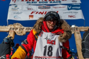 Mitch Seavey poses for a photo at the Nome finish line after finishing in second place on Wednesday March 18, 2015 during Iditarod 2015.  (C) Jeff Schultz/SchultzPhoto.com - ALL RIGHTS RESERVED DUPLICATION  PROHIBITED  WITHOUT  PERMISSIO8