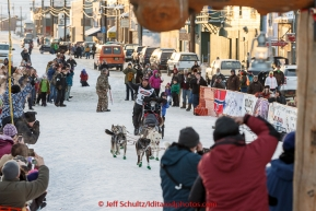 Aaron Burmeister and his son Hunter run into the finish chute in Nome in third place on Wednesday March 18, 2015 during Iditarod 2015.  (C) Jeff Schultz/SchultzPhoto.com - ALL RIGHTS RESERVED DUPLICATION  PROHIBITED  WITHOUT  PERMISSION