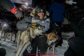 Dallas Seavey hugs his lead dogs Reef and Hero shortly after winning the 2015 Iditarod in 8 days 18 hours 13 minutes 6 seconds on Wednesday March 18, 2015  (C) Jeff Schultz/SchultzPhoto.com - ALL RIGHTS RESERVED DUPLICATION  PROHIBITED  WITHOUT  PERMISSION