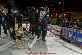 Dallas Seavey walks his lead dogs Reef and Hero in front of the crowd after winning his 3rd Iditarod in 8 days 18 hours 13 minutes 6 seconds on Wednesday March 18, 2015 during Iditarod 2015.  (C) Jeff Schultz/SchultzPhoto.com - ALL RIGHTS RESERVED DUPLICATION  PROHIBITED  WITHOUT  PERMISSION