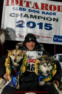 Dallas Seavey's dogs Reef and Hero recieve the garland of roses on the winner stand after Dallas won his 3rd Iditarod in 8 days 18 hours 13 minutes 6 seconds on Wednesday March 18, 2015 during Iditarod 2015.  (C) Jeff Schultz/SchultzPhoto.com - ALL RIGHTS RESERVED DUPLICATION  PROHIBITED  WITHOUT  PERMISSION