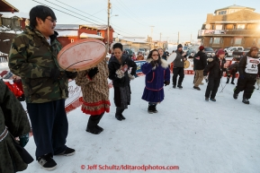 The Nome St. Lawrence Island Dancers play and dance at the Nome finish line on Wednesday March 18, 2015 as Aaron Burmeister crossed the finish line during Iditarod 2015.  (C) Jeff Schultz/SchultzPhoto.com - ALL RIGHTS RESERVED DUPLICATION  PROHIBITED  WITHOUT  PERMISSION
