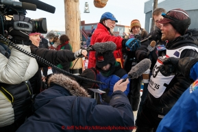 Radio and TV crews interview Aaron Burmeister shorlty after his arrival in third place at the Nome finish line on Wednesday March 18, 2015 during Iditarod 2015.  (C) Jeff Schultz/SchultzPhoto.com - ALL RIGHTS RESERVED DUPLICATION  PROHIBITED  WITHOUT  PERMISSION