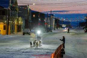 Matthew Failor runs down Front Street as he arrives in the finish chute in Nome in 59th place during the 2017 Iditarod on Saturday March 18, 2017.Photo by Jeff Schultz/SchultzPhoto.com  (C) 2017  ALL RIGHTS RESERVED