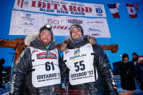 Matthew Failor and Michael Baker in the finish chute in Nome during the 2017 Iditarod on Saturday March 18, 2017.Photo by Jeff Schultz/SchultzPhoto.com  (C) 2017  ALL RIGHTS RESERVED