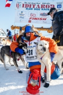 Last place finisher and Red Lantern Award winner Cindy Abbott poses with her lead dog in Nome during the 2017 Iditarod on Saturday March 18, 2017.Photo by Jeff Schultz/SchultzPhoto.com  (C) 2017  ALL RIGHTS RESERVED