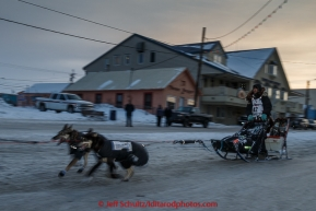 Richie Diehl runs down Front Street toward the finish line in Nome on Thursday March 19, 2015 during Iditarod 2015.  (C) Jeff Schultz/SchultzPhoto.com - ALL RIGHTS RESERVED DUPLICATION  PROHIBITED  WITHOUT  PERMISSION