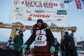 Richie Diehl poses for a photo after his finish at the burl arch in Nome on Thursday March 19, 2015 during Iditarod 2015.  (C) Jeff Schultz/SchultzPhoto.com - ALL RIGHTS RESERVED DUPLICATION  PROHIBITED  WITHOUT  PERMISSION