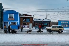 Spectators welcome Nathan Schroeder to Nome as he runs down Front Street on his way toward the finish line in Nome on Thursday March 19, 2015 during Iditarod 2015.  (C) Jeff Schultz/SchultzPhoto.com - ALL RIGHTS RESERVED DUPLICATION  PROHIBITED  WITHOUT  PERMISSION