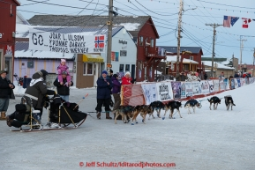 Nathan Schroeder runs into the finish chute toward the finish line in Nome on Thursday March 19, 2015 during Iditarod 2015.  (C) Jeff Schultz/SchultzPhoto.com - ALL RIGHTS RESERVED DUPLICATION  PROHIBITED  WITHOUT  PERMISSION