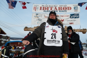 Nathan Schroeder poses for a photo at the finish line in Nome after completing his race on Thursday March 19, 2015 during Iditarod 2015.  (C) Jeff Schultz/SchultzPhoto.com - ALL RIGHTS RESERVED DUPLICATION  PROHIBITED  WITHOUT  PERMISSION
