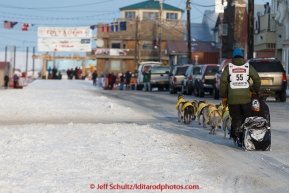 Matts Pettersson runs down Front Street on his way toward the finish line in Nome on Thursday March 19, 2015 during Iditarod 2015.  (C) Jeff Schultz/SchultzPhoto.com - ALL RIGHTS RESERVED DUPLICATION  PROHIBITED  WITHOUT  PERMISSION
