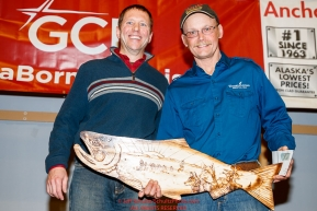 The Bristol Bay Native Corporation Fish First Award is presented by Daniel Chayette, vice president, associate general counsel for Bristol Bay Native Corporation to Mitch Seavey at the Nome Musher's Award Banquet during the 2017 Iditarod on Sunday March 19, 2017.Photo by Jeff Schultz/SchultzPhoto.com  (C) 2017  ALL RIGHTS RESERVED
