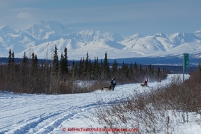 Jordan Seager, Andrew Noland and Katie Deits teams run down the trail on the Denali Highway with the Alaska Range in the background during the start day of the 2015 Junior Iditarod on Sunday March 1, 2015(C) Jeff Schultz/SchultzPhoto.com - ALL RIGHTS RESERVED DUPLICATION  PROHIBITED  WITHOUT  PERMISSION