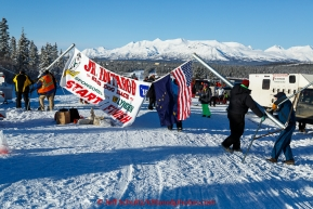 Volunteers erect the start and finish banner for the 2015 Junior Iditarod start along the Denali Highway on Sunday March 1, 2015.(C) Jeff Schultz/SchultzPhoto.com - ALL RIGHTS RESERVED DUPLICATION  PROHIBITED  WITHOUT  PERMISSION