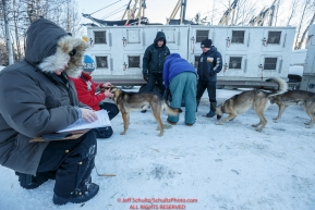 Volunteer veterinarians fill out paperwork on each and every dog as they are examined during the pre-race vet-check for dogs running this year's 2017 Iditarod at Iditarod Headquarters in Wasilla, Alaska.  Wednesday March 1, 2017Photo by Jeff Schultz/SchultzPhoto.com  (C) 2017  ALL RIGHTS RESVERVED