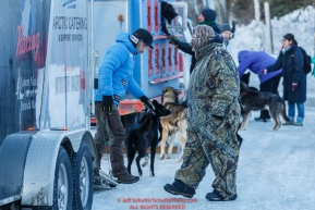 Spectators brave the 30mph wind to view the dogs and see the mushers at the pre-race vet-check for dogs running this year's 2017 Iditarod at Iditarod Headquarters in Wasilla, Alaska.  Wednesday March 1, 2017Photo by Jeff Schultz/SchultzPhoto.com  (C) 2017  ALL RIGHTS RESVERVED